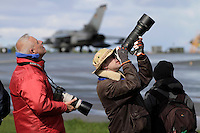 Plane spotters use expensive cameras and big lenses to capture aircraft. Nato Tiger Meet is an annual gathering of squadrons using the tiger as their mascot. While originally mostly a social event it is now a full military exercise. Tiger Meet 2012 was held at the Norwegian air base Ørlandet.