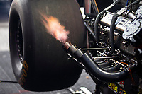 May 5, 2018; Commerce, GA, USA; Detailed view of flames from the header pipes on the engine of the dragster of NHRA top fuel driver Leah Pritchett during qualifying for the Southern Nationals at Atlanta Dragway. Mandatory Credit: Mark J. Rebilas-USA TODAY Sports