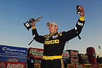 Feb. 27, 2011; Pomona, CA, USA; NHRA top fuel dragster driver Morgan Lucas celebrates after winning the Winternationals at Auto Club Raceway at Pomona. Mandatory Credit: Mark J. Rebilas-