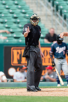 Home plate umpire Clint Vondrak calls a strike on a batter during a game between the Reno Aces and the Fresno Grizzlies at Chukchansi Park on April 8, 2019 in Fresno, California. Fresno defeated Reno 7-6. (Zachary Lucy/Four Seam Images)