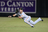Surprise Saguaros outfielder Dariel Alvarez (1), of the Baltimore Orioles organization, makes a diving catch during an Arizona Fall League game against the Salt River Rafters on October 15, 2013 at Salt River Fields at Talking Stick in Scottsdale, Arizona.  Surprise defeated Salt River 9-2.  (Mike Janes/Four Seam Images)