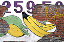 Peeling poster of a banana and lemon on a brick wall near Eastern Market in Detroit.