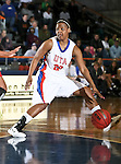 Texas - Arlington Mavericks guard Tamara Simmons (20) dribbles the ball in the game between the UTA Mavericks and the  Nicholls State University Colonels  held at the University of Texas in Arlington's Texas Hall in Arlington, Texas. UTA defeats Nicholls 69 to 62