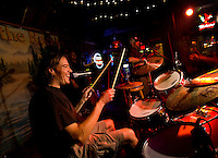 A drummer keeps the beat at the Buckhead Saloon in Charlotte, NC. Photos taken with permission of bar management.