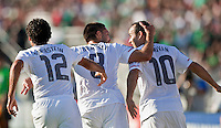 PASADENA, CA – June 25, 2011: USA players Jonathan Bornstein (12), Clint Dempsey (8) and Landon Donovan (10) celebrating a goal during the Gold Cup Final match between USA and Mexico at the Rose Bowl in Pasadena, California. Final score USA 2 and Mexico 4.
