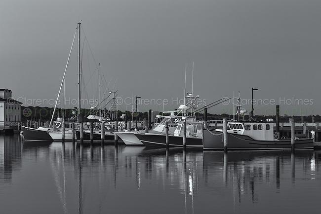 Commercial fishing boats docked in Menemsha Basin shortly before sunrise, in the fishing village of Menemsha in Chilmark, Massachusetts on Martha's Vineyard.