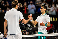 21st February 2021, Melbourne, Victoria, Australia; Novak Djokovic of Serbia consoles Daniil Medvedev of Russia at the net after Novak Djokovic of Serbia wins the Men's Singles Final of the 2021 Australian Open on February 21 2021, at Melbourne Park in Melbourne, Australia.