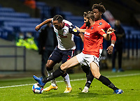 Bolton Wanderers' Nathan Delfouneso (left) competing with Salford City's Jordan Turnbull<br /> <br /> Photographer Andrew Kearns/CameraSport<br /> <br /> The EFL Sky Bet League Two - Bolton Wanderers v Salford City - Friday 13th November 2020 - University of Bolton Stadium - Bolton<br /> <br /> World Copyright © 2020 CameraSport. All rights reserved. 43 Linden Ave. Countesthorpe. Leicester. England. LE8 5PG - Tel: +44 (0) 116 277 4147 - admin@camerasport.com - www.camerasport.com