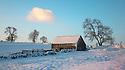 Stone field barn at dawn following heavy snowfall. Peak DIstrict National Park, Derbyshrie, UK. December.