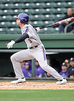 Outfielder Luke Dauch (23) of the Northwestern Wildcats hits in a game against the Furman University Paladins on Saturday, February 16, 2013, at Fluor Field in Greenville, South Carolina. The game was cancelled in the fifth inning due to snow. (Tom Priddy/Four Seam Images)