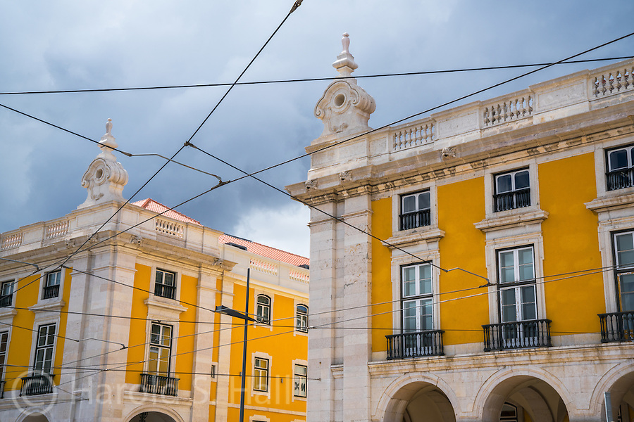 Portuguese like their buildings yellow.  When we were in the Portuguese section of Macau China, we saw the same trend.  These are the trolley car wires around Commerce Square in Lisbon, Portugal.