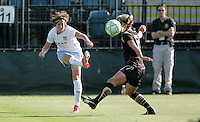 Megan Rapinoe (left) kicks the ball against Leslie Osborne (right). FC Gold Pride tied the Chicago Red Stars 1-1 at Buck Shaw Stadium in Santa Clara, California on June 7th, 2009.