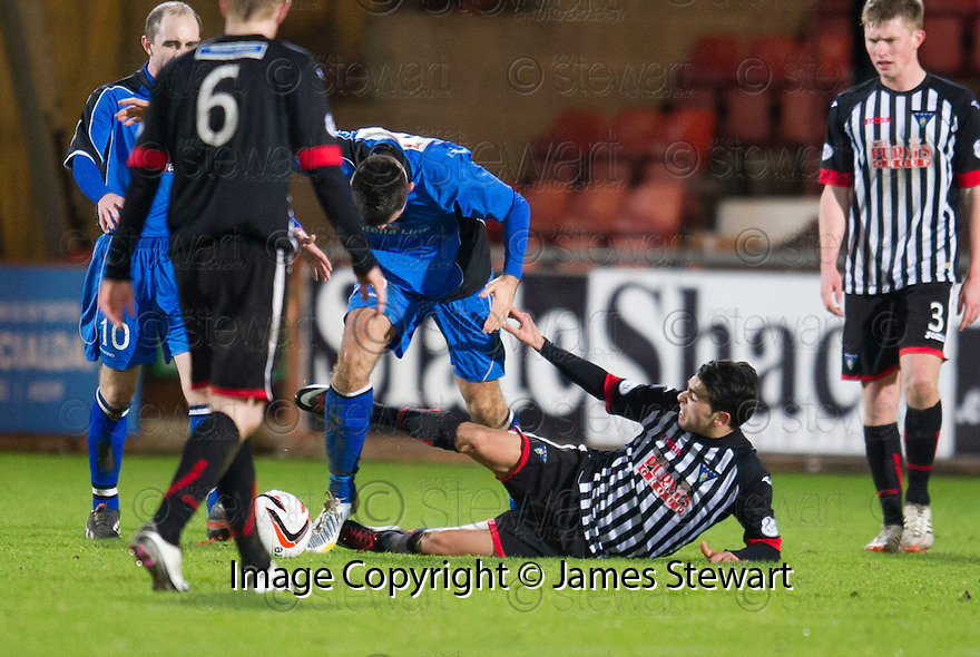 Pars' Faissal El Bakhtaoui gets a straight red card for kicking out at Stranraer's Steven Bell.