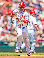 25 July 2013: Washington Nationals outfielder Bryce Harper hustles home to score during a game against the Pittsburgh Pirates at Nationals Park in Washington, DC. The Nationals salvaged the last game of their series, winning 9-7 ending their 6-game losing streak. Mandatory Credit: Ed Wolfstein Photo *** RAW (NEF) Image File Available ***