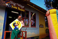 Owner of the Big Wind Kite Factory standing in front of his store