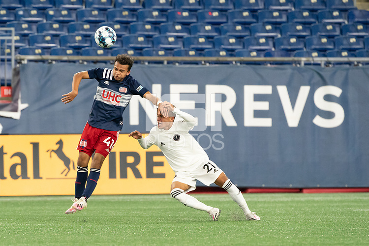 FOXBOROUGH, MA - OCTOBER 09: Colby Quinones #41 of New England Revolution II heads the ball away from Edison Azcona #21 of Fort Lauderdale CF during a game between Fort Lauderdale CF and New England Revolution II at Gillette Stadium on October 09, 2020 in Foxborough, Massachusetts.