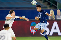 CARSON, CA - OCTOBER 18: Michael Baldisimo #55 of the Vancouver Whitecaps heads a ball during a game between Vancouver Whitecaps and Los Angeles Galaxy at Dignity Heath Sports Park on October 18, 2020 in Carson, California.