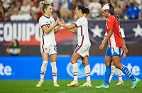 CLEVELAND, OH - SEPTEMBER 16: Kristie Mewis #22 and Carli Lloyd #10 of the United States celebrate a Carlie Lloyd; Hat Trick Goal during a game between Paraguay and USWNT at FirstEnergy Stadium on September 16, 2021 in Cleveland, Ohio.