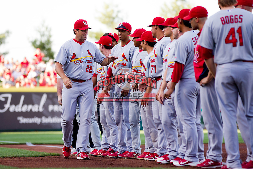 Manager Mike Matheny (22) of the St. Louis Cardinals high fives his team after being introduced prior to a game against the Springfield Cardinals at Hammons Field on April 2, 2012 in Springfield, Missouri. (David Welker/Four Seam Images)