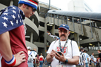 A volunteer talks with a fan prior to the start of the match. The men's national teams of the United States and Argentina played to a 0-0 tie during an international friendly at Giants Stadium in East Rutherford, NJ, on June 8, 2008.