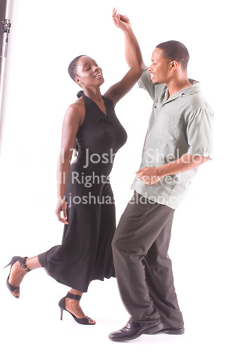 African American couple dancing together