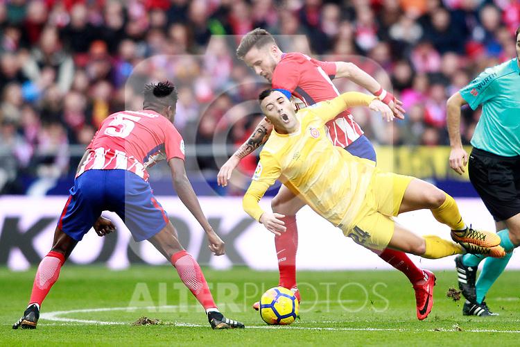 Atletico de Madrid's Thomas Partey (l) and Saul Niguez (c) and Girona FC's Borja Garcia during La Liga match. January 20,2018. (ALTERPHOTOS/Acero)