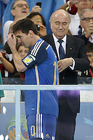 Lionel Messi of Argentina looks dejected as he walks past FIFA President Sepp Blatter