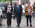 First Minister arrives at the polling station in his home village of Strichen with Natasha McDonald, 17, and Lia Pirie, 28.