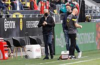 16th May 2020, Signal Iduna Park, Dortmund, Germany; Bundesliga football, Borussia Dortmund versus FC Schalke; 04 BVB Trainer  Lucien Favre in protective mask during the game