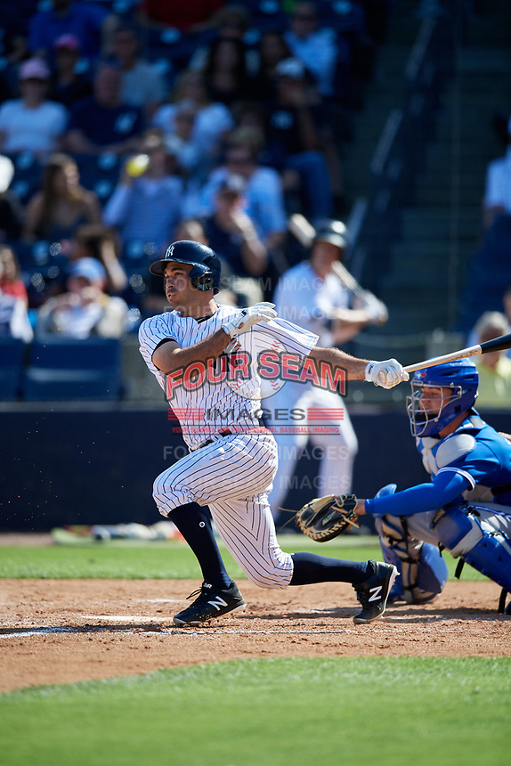 New York Yankees pinch hitter Jorge Saez (80) hits into a fielder's choice and drives in a run during a Grapefruit League Spring Training game against the Toronto Blue Jays on February 25, 2019 at George M. Steinbrenner Field in Tampa, Florida.  Yankees defeated the Blue Jays 3-0.  (Mike Janes/Four Seam Images)