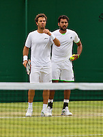 01-07-13, England, London,  AELTC, Wimbledon, Tennis, Wimbledon 2013, Day seven, Jean-Julien Rojer (NED) (L)and his doubles partner Aisam Qureshi (PAK)<br /> <br /> <br /> <br /> Photo: Henk Koster