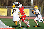 Baltimore, MD - March 3: Attackmen Eric Warden #5 of the Fairfield Stags dodges Defensemen/long stick midfielder Ethan Murphy #13 of the UMBC Retrievers  during the Fairfield v UMBC mens lacrosse game at UMBC Stadium on March 3, 2012 in Baltimore, MD.