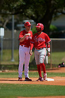 Philadelphia Phillies coach Bobby Wernes talks with Jonathan Guzman (8) during an exhibition game against the Canada Junior National Team on March 11, 2020 at Baseball City in St. Petersburg, Florida.  (Mike Janes/Four Seam Images)