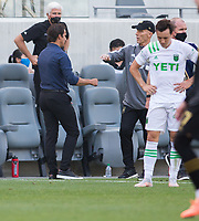 LOS ANGELES, CA - APRIL 17: Head coaches Josh Wolff of Austin FC and Bob Bradley of LAFC congratulate one another after the match during a game between Austin FC and Los Angeles FC at Banc of California Stadium on April 17, 2021 in Los Angeles, California.
