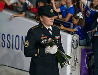 ORLANDO, FL - MARCH 05: The military escort carries out the SheBelieves trophy during a game between England and USWNT at Exploria Stadium on March 05, 2020 in Orlando, Florida.