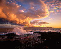 Wave Crashing Against Coral Reef Into Tidepool & Sunset on Huge Cloud Formation, Ahihi Bay, Maui, Hawaii, USA.