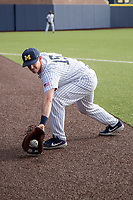 Michigan Wolverines first baseman Jimmy Kerr (15) warms up before the NCAA baseball game against the Eastern Michigan Eagles on May 8, 2019 at Ray Fisher Stadium in Ann Arbor, Michigan. Michigan defeated Eastern Michigan 10-1. (Andrew Woolley/Four Seam Images)