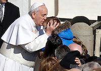 Papa Francesco saluta un bambino al termine dell'udienza generale del mercoledi' in Piazza San Pietro, Citta' del Vaticano, 18 febbraio 2015.<br /> Pope Francis greets a child at the end of his weekly general audience in St. Peter's Square at the Vatican, 18 February 2015.<br /> UPDATE IMAGES PRESS/Isabella Bonotto<br /> <br /> STRICTLY ONLY FOR EDITORIAL USE