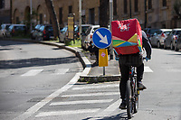 """Food Runner...<br /> <br /> Rome, 25/04/2020. Today, to mark the 75th Anniversary of the Italian Liberation from nazi-fascism (Liberazione) in Rome, I documented backwards the route of the annual march (Corteo) from Garbatella (South Rome's District in the VIII Municipio / Municipality which in 2020 celebrates 100 years from its foundation) to Piazzale Ostiense (1.) where usually a rally took place attended by Partizans / Partigiani (2.), Veterans and politicians. This year people were not allowed to attend the Commemoration (held with just a delegation of WWII Italian Partizans / Partigiani - including ANPI (3.) - along with the Mayor of Rome and few other Institutional Representatives) due to the spread of the 2019-20 Coronavirus pandemic (SARS-CoV-2 – infection: COVID-19, 5.) which already killed more than 200,000 people in the world (Data by WHO / OMS). The day ended with a flashmob held from the windows of Garbatella's Palladium (6.), where people sang two of the most famous Partizans / Partigiani's Anthems: Bella Ciao and Fischia Il Vento, the Italian Anthem """"Il Canto Degli Italiani / Inno d'Italia / Inno di Mameli"""", and few other songs (4.) which celebrate and remember the Partisans / Partigiani, their Sacrifice for the Freedom, the Italian Constitution, and the Future of Italy and Europe without fascisms and dictatorships.<br /> <br /> Footnotes & Links:<br /> 1. (25 Aprile 2018) http://tiny.cc/dsi3nz<br /> 2. (I Partigiani) http://tiny.cc/cwi3nz<br /> 3. http://www.anpi.it<br /> 4. Video (Source, Repubblica.it) : http://tiny.cc/3yi3nz<br /> 5. Rome's Lockdown: http://tiny.cc/d3i3nz & http://tiny.cc/w5i3nz <br /> 6. (Source, Wikipedia.org ENG) http://tiny.cc/6fm3nz <br /> (Liberazione: Source, Wikipedia.org ENG) http://tiny.cc/l9i3nz"""