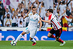 Lucas Vazquez (L) of Real Madrid fights for the ball with Inigo Cordoba Kerejeta of Athletic Club de Bilbao during the La Liga 2017-18 match between Real Madrid and Athletic Club Bilbao at Estadio Santiago Bernabeu on April 18 2018 in Madrid, Spain. Photo by Diego Souto / Power Sport Images