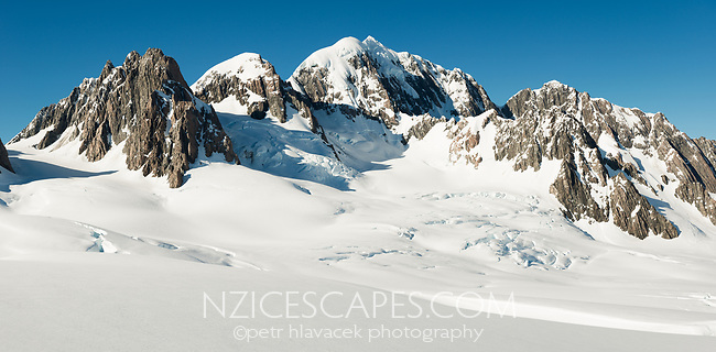 Morning views of second highest peak of Southern Alps, Mount Tasman 3497m in centre with Mt. Lendenfeld 3194m and Mount Haast 3114m on left and Torres Peak 3160m on right, Westland Tai Poutini National Park, West Coast, UNESCO World Heritage, New Zealand, NZ