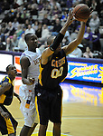 13 December 2008: Greg Logins of Canisius rebounds during a game between Canisius and Albany won by Albany 74-46 at SEFCU Arena in Albany, New York.
