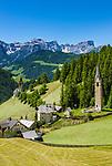 Italy, South Tyrol (Trentino - Alto Adige), La Valle: hamlet Tolpei with steeple of parish church St Genesius in Old-Wengen (right), behind (left) the chapel Saint Barbara, at background Puez-Geisler-Group at Puez-Geisler Nature Park (Parco naturale Puez Odle) | Italien, Suedtirol (Trentino - Alto Adige), Wengen: der Weiler Tolpei mit dem Turm der alten Pfarrkirche St. Genesius in Altwengen (rechts) und links dahinter die spaetgotische Barbarakapelle, im Hintergrund die Puez-Geisler-Gruppe im Naturpark Puez-Geisler