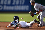 Reno Aces' Dan Rohlfing dives safely into second base against Oklahoma City's Brandon Hicks at Greater Nevada Field in Reno, Nev., on Sunday, July 17, 2016.<br />