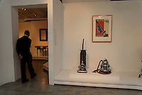 A guard passes by the vacuum cleaners on display at the Wolfsonian Museum 1001 Washington Avenue, Miami Beach, FL 33139-5017 <br />  <br /> The Wolfsonian-FIU is a Florida International University museum devoted to late-19th and early-20th century design. Located in the historic Art Deco district of Miami Beach, Florida, the Wolfsonian was founded by Mitchell Wolfson, Jr. in 1986 to display and preserve his personal art collection.  He donated the collection and its building to Florida International University in 1997.<br /> The museum's exhibits occupy 3 floors of a renovated 7-story warehouse (56,000 square feet), with its workshops, offices, and library occupying the remaining space.<br /> The collections feature furniture and decorative arts, paintings and sculpture, books, prints, and posters that reflect social, political and technological changes between 1885 and 1945. Artifacts are primarily of North American and European origin.