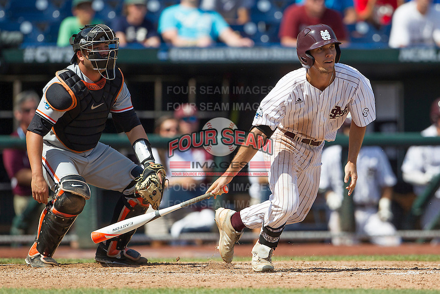 Mississippi State shortstop Adam Fraizer (12) follows through on his swing during Game 11 of the 2013 Men's College World Series against the Oregon State Beavers on June 21, 2013 at TD Ameritrade Park in Omaha, Nebraska. The Bulldogs defeated the Beavers 4-1, to reach the CWS Final and eliminating Oregon State from the tournament. (Andrew Woolley/Four Seam Images)