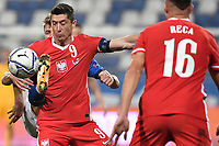 Nicolo Barella of Italy and Robert Lewandowski of Poland compete for the ball during the Uefa Nation League Group Stage A1 football match between Italy and Poland at Citta del Tricolore Stadium in Reggio Emilia (Italy), November, 15, 2020. Photo Andrea Staccioli / Insidefoto