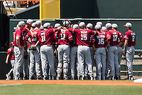 Oklahoma Sooners team huddle before the NCAA baseball game against the Texas Longhorns on April 6, 2013 at UFCU DischFalk Field in Austin, Texas. The Longhorns defeated the rival Sooners 1-0. (Andrew Woolley/Four Seam Images).
