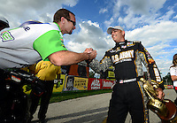 Sept 9, 2012; Clermont, IN, USA: NHRA top fuel dragster driver Tony Schumacher (right) is congratulated by funny car driver and teammate Jack Beckman after winning the US Nationals at Lucas Oil Raceway. Mandatory Credit: Mark J. Rebilas-