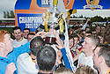 Alloa manager Paul Hartley and his players are mobbed by the fans after lifting the 3rd division trophy.